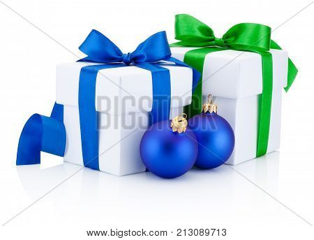 Two white gift boxes and Christmas baubles Isolated on white background