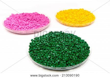 The Plastic Granules. Dye For Polypropylene, Polystyrene Granules Into A Measuring Container