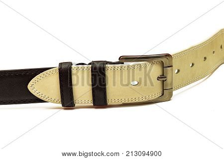 In the buckle of the black belt is inserted a white leather belt