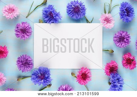 Greeting card on floral background with cornflowers