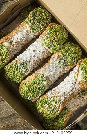 Traditional Homemade Sicilian Cannolis with Pistachios and Cream