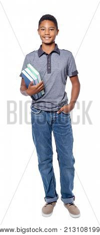 African-American teenager with textbooks on white background
