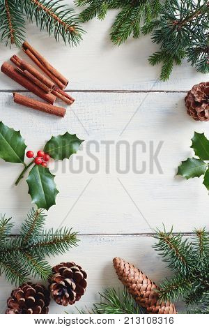 Christmas background with Christmas decorations on wooden white table.