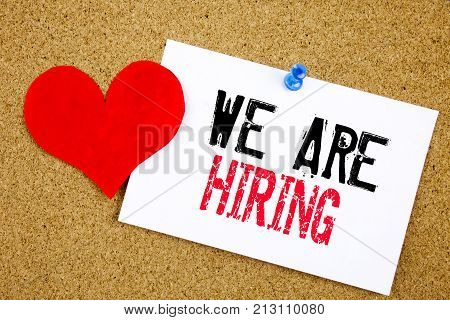 Now Hiring Written On Sticky Note Message