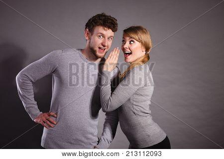 Joyful Couple Gossip To Each Other.