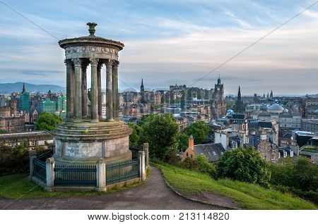 EDINBURGH, SCOTLAND - JUNE 18, 2016 - View of Edinburgh from Calton Hill with the Dugald Stewart Monument in the foreground