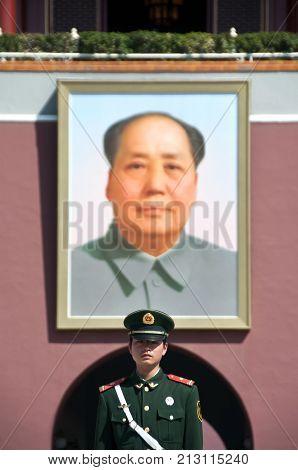 BEIJING, CHINA - APRIL 4, 2012 - Mao portrait and guard outside Tiananmen Gate, Beijing