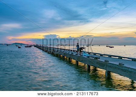 Pier and sea view during sunset in Siracha Thailand