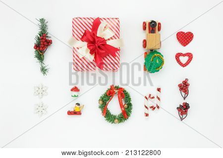 Flat lay aerial image of decorations & ornaments Merry Christmas & Happy New Year concept.Festive decor for winter season.Essential accessories objects on modern classic wooden white background.