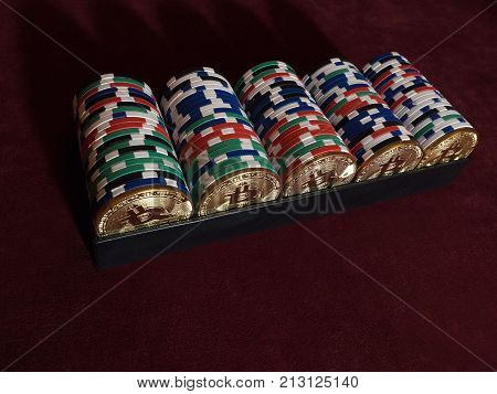 Bitcoi coins with poker chips on red cloth. The concept of replacing bitcoin with all payment methods.