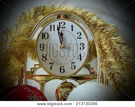 Time on the clock is approaching the New Year. Less than five minutes before the New Year. Celebratory background. New Year's and Christmas