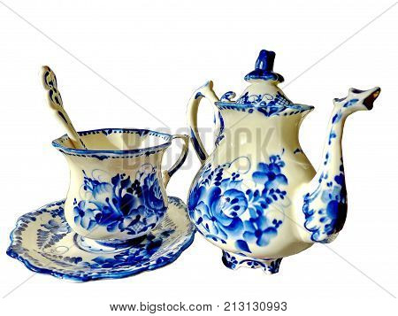 Teapot, cup with saucer and teaspoon on a white background. Things in Russian traditional Gzhel style. Gzhel-Russian folk craft of ceramics and production porcelain and a kind of Russian folk painting