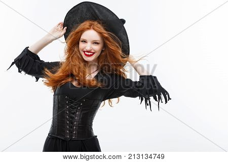 Halloween Witch Concept - Happy Halloween Ginger Hair Witch. Isolated On White Background.