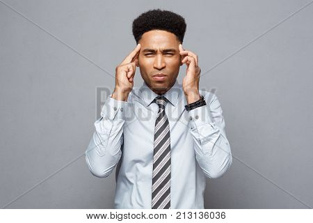 Business Concept - Portrait Of Frustrated Stressed African American Business Man On Grey Background.