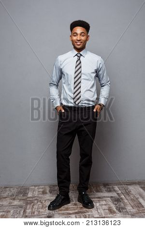 Business Concept - Full Length Portrait Of Confident African American Businessman In The Office.