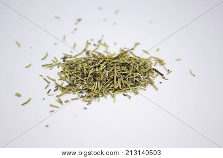 Spilled dry rosemary on the white background
