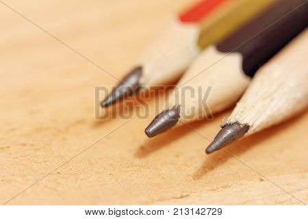 sharpened pencils on a wooden background closeup.