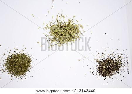 Different spilled spices on the white background