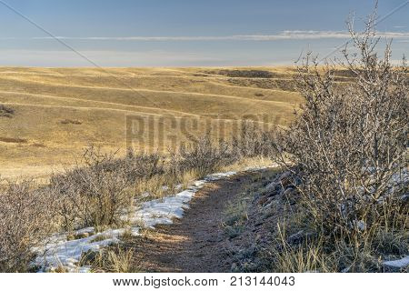 a single track trail on Cheyenne RIm in Red Mountain Open Space at border of Colorado and Wyoming, fall scenery
