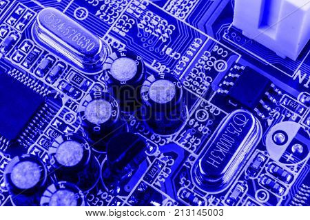 Resistors, Capacitors And Other Electronic Components Of Micro Chip Inside The Computer Close Up
