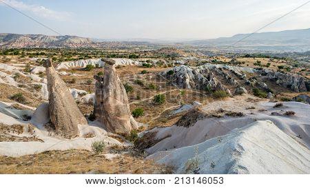 Goreme village Turkey - August 2017: . Rural Cappadocia landscape. Stone houses of Cappadocia. Sunny Goreme. Countryside lifestyle of Cappadocia Turkey