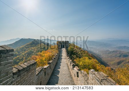 China The great wall distant view compressed towers and wall segments autumn season in mountains near Beijing ancient chinese fortification military landmark in Beijing China.