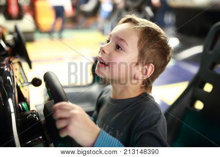 Kid Playing In Car Simulator