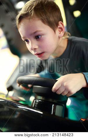 Preschooler Playing In Car Simulator