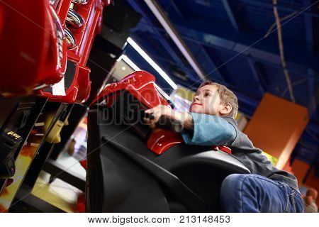 Preschooler Playing In Motorcycle Simulator