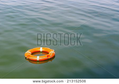 A lifebuoy floating on water for concept use