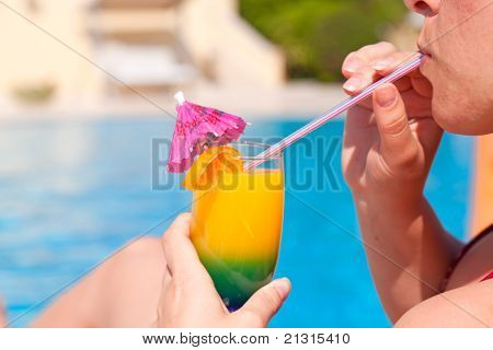 Woman Hand Drinking Cocktail