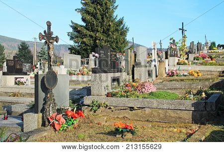 various decorated graves on the cemetery in Prazmo, Czech Republic, November 4, 2017