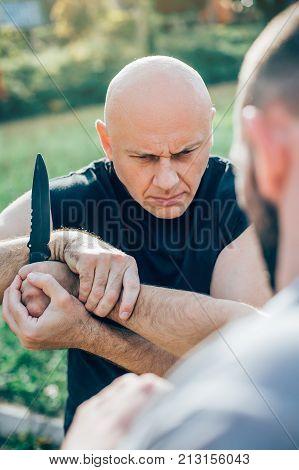Kapap Instructor Demonstrates Martial Arts Self Defense Knife Attack Disarming
