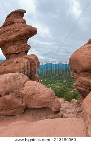 garden of the gods national natural landmark rock formations framing valley and mountains in colorado springs colorado