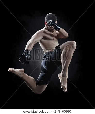 mmamake fighter performing a knee kick in the air isolated