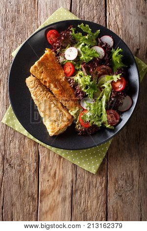 Fried In A Battered Hake And Fresh Salad Close-up. Vertical Top View