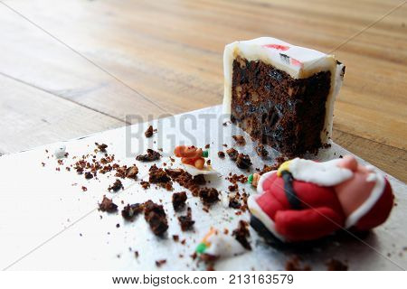 The Very Last Piece Of A Home Made Christmas Cake,with A Collapsed Sugarcraft Father Christmas, Or S
