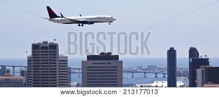 SAN DIEGO, CALIFORNIA, JUNE 9. Downtown on June 9, 2017, in San Diego, California. A Delta Jet on Approach Over Downtown San Diego California.