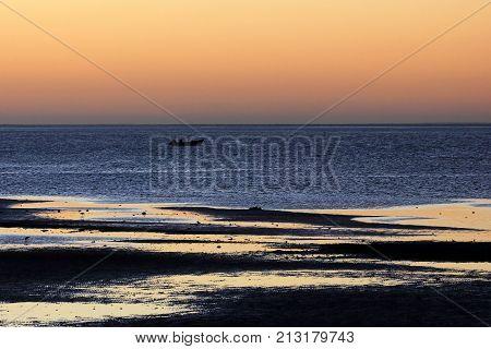 Fishing boat at sunset in the bay of the San Ignacio Lagoon, Baja California, Mexico, North America