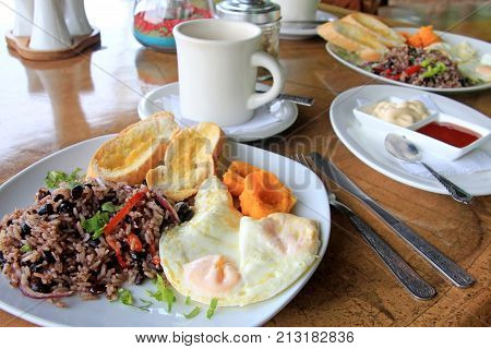 Traditional Gallo Pinto breakfast with eggs, Costa Rica, Central America