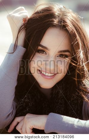 Dental care stomatology. Woman happy smile with long brunette hair on sunny day. Fashion beauty visage. Skincare youth health concept. Girl face with makeup on healthy skin in nature.