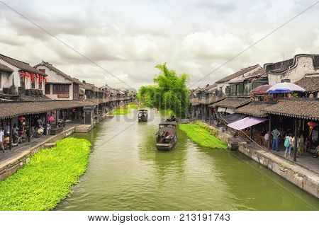 August 8 2015. Xitang Town China. Chinese style buildings and tourist boats on the water canals of Xitang town in Jiashan county in Zhejiang province China.