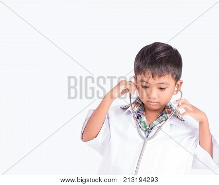 Cute asian little boy wearing a doctor's coat on white background