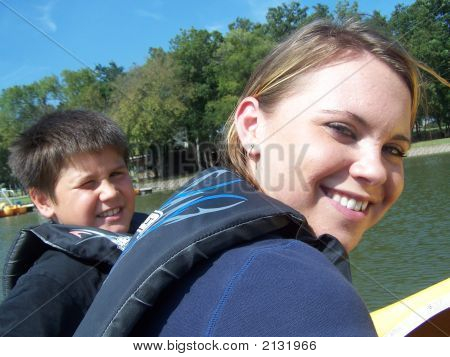 Two Kids In A Paddle Boat