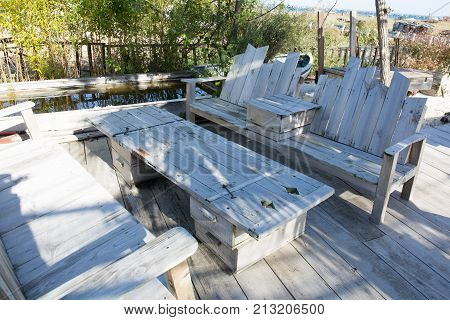 Wooden Lounge Bench Made Of Construction Wood. Stylish Diy Bench On The Terrace In The Garden
