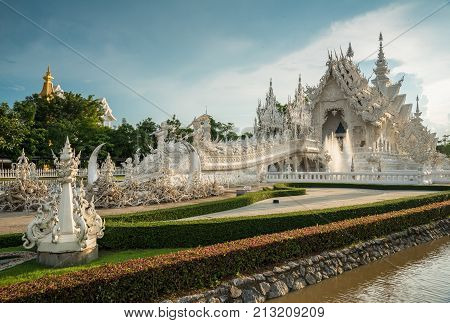 Chiangrai, Thailand - June 23 2016: 'The White Temple' in Chiang Rai, otherwise known as 'Wat Rong Khun' in Thai, The bizarre brainchild of Thai National Artist Chalermchai Kositpipat.