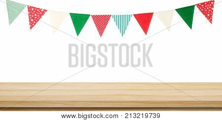 Empty wood table and Christmas new year party colorful flags isolated on white background wooden tabletop shelf counter and ornament flag design background for product display montage template