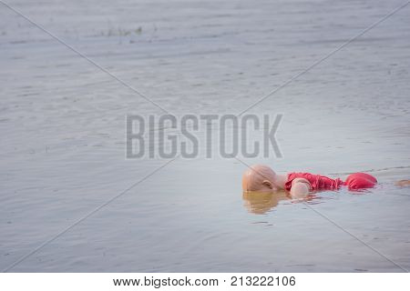 child model drowning wear life jacket on the water