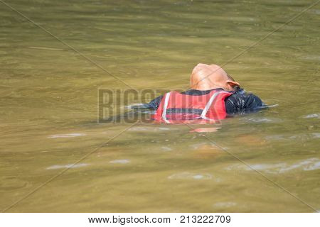 male drowning wear life jacket on the water
