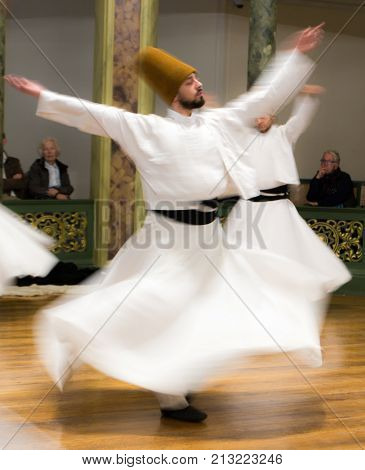 Blurred Whirling Dervishes Practice Their Dance